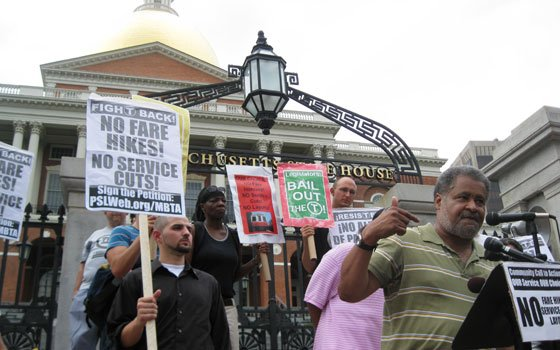 Bob Terrell (right), leader of the On the Move Coalition, speaks during a rally held Monday, Aug. 10,...