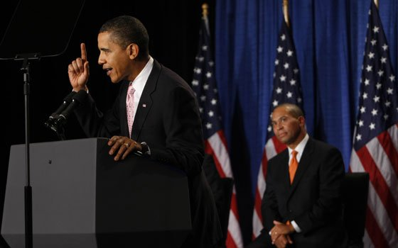 Massachusetts Gov. Deval Patrick looks on at right as President Barack Obama speaks at a fundraiser for Patrick,...