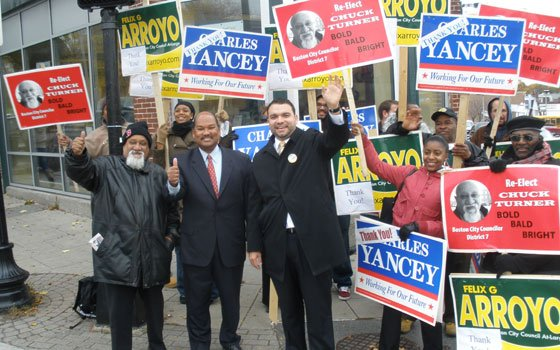 City Councilors Chuck Turner (left) and Charles Yancey (center) celebrate Felix Arroyo's (third from left) decisive victory in...