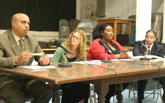 Winston Cox makes a point as Susan Eaton, Janine Quarles and Sam Depina listen during a forum on...