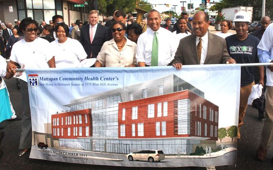 More than 200 people joined Dr. Azzie Young, president and CEO of Mattapan Community Health Center (center), Gov.Deval...