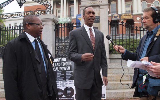 Massachusetts Black Empowerment Coalition Executive Director Kevin Peterson and spokesman Barry Lawton speak to reporters outside the Statehouse...