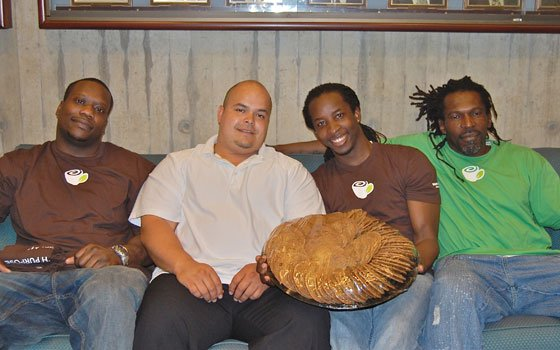 Resolutions praise food-based service model, transitional program for ex-convictsDaniel Cordon (second from l) with graduates of the...