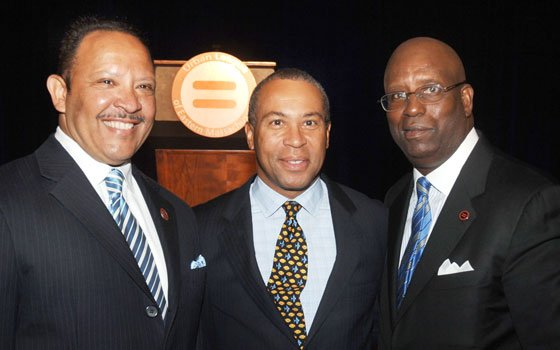National Urban League President Marc Morial joins Gov. Deval Patrick and Darnell Williams, president of the Urban League of...