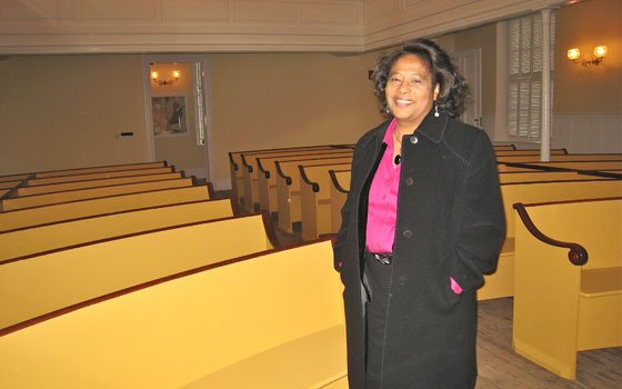 Beverly Morgan-Welch, executive director of the Museum of African American History, stands in the newly restored sanctuary of the...