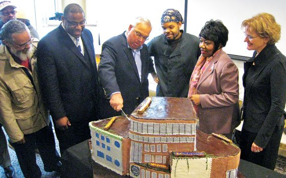 Mayor Thomas Menino cuts the cake after the March 3 groundbreaking ceremony. (L to R) State Rep. Byron...