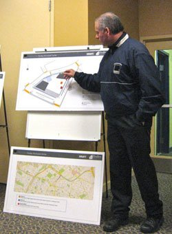 Bob Wice of Shawmut Design and Construction describes traffic and parking effects around the Ferdinand site, where construction is beginning on a new municipal and retail building.