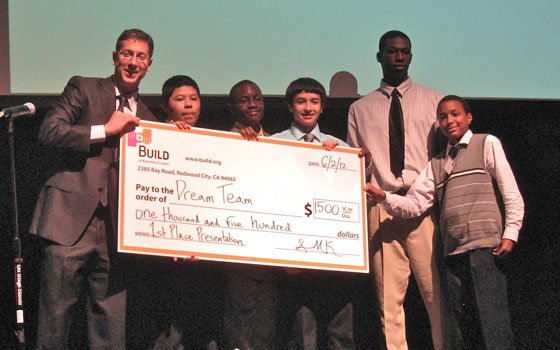 Entrepreneurship students from Charlestown High School receive their prize money for winning the BUILD Youth...