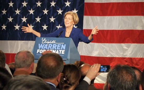 US Senator-elect Elizabeth Warren delivers her victory speech at the Fairmount Copley Hotel after beating incumbent...
