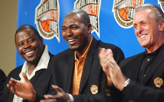 Former NBA players Patrick Ewing (left) and Hakeem Olajuwon (center) and coach Pat Riley share a light moment...