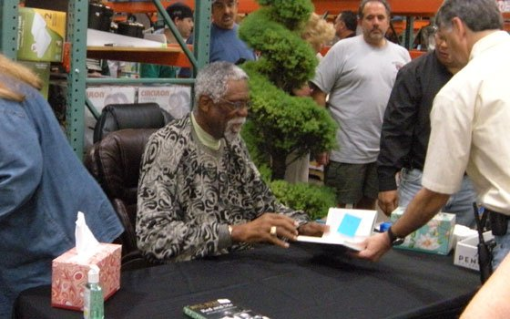 "Former Boston Celtics great Bill Russell (left) signs copies of his new book, ""Red and Me: My Coach,..."