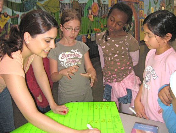 Venessa Peña (left), a medical student at Harvard University, helps young Science Club for Girls participants make a...