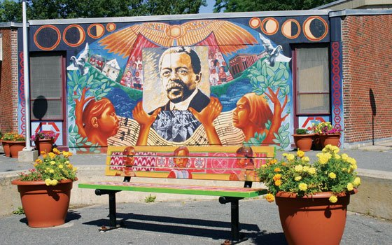 "A mural celebrating ""The Guardian's"" publisher at the William Monore Trotter Elementary School in Dorchester. (Banner file photo)..."