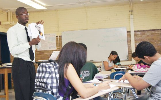 Teach for America instructor Evin Nembhard stands in front of his science class at Newcomers Academy in Dorchester...