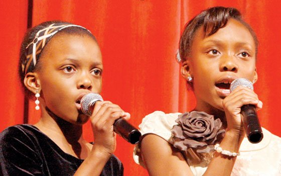 Oladunni Oladipo, 11, and her sister Olayeni Oladipo, 9, have performed numerous duets throughout the city and are ...