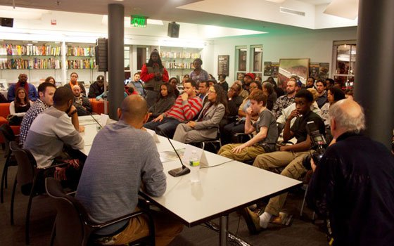 A diverse crowd packs Harvard University's Hip Hop Archive to listen to Grammy Award-winning producer 9th Wonder discuss his...