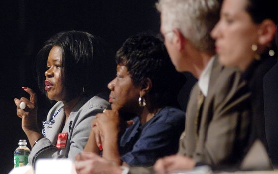 Then-state Sen. Dianne Wilkerson (left) makes a point during a community forum held at Roxbury Community College on...