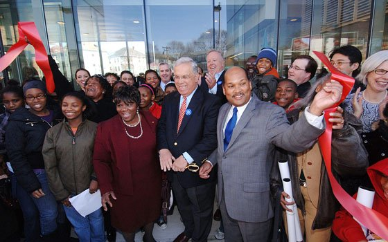 Flanked by state Rep. Willie Mae Allen (left) and City Councilor Charles C. Yancey (right), Mayor Thomas M....