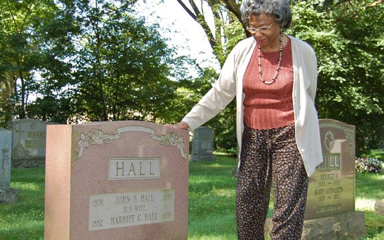 Sylvia McDowell, scholar-in-residence at Forest Hills Cemetery in Jamaica Plain, stands at the gravesite of Harriet C. Hall,...