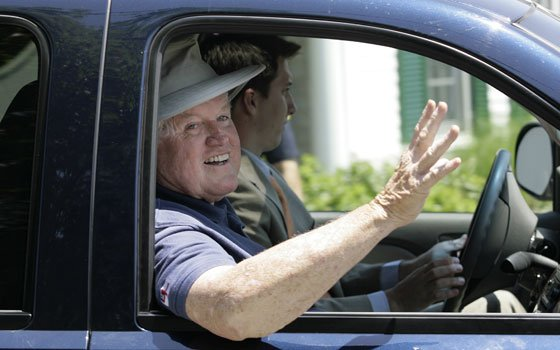 Sen. Edward M. Kennedy, D-Mass., waves as he returns to his Hyannis Port home on Monday, June 9,...