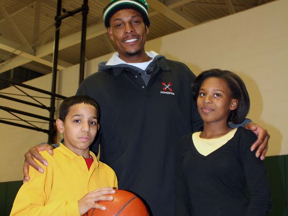 Boston Celtic Captain Paul Pierce poses with Matthew Castro and Nyjaisha Washington, both of Dorchester, at the Boys...