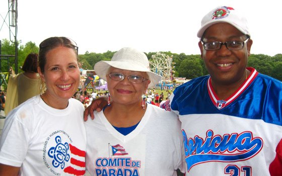 "Puerto Rican Festival Treasurer Giovanna Negretti, President Reinelda ""Chiqui"" Rivera and Vice President Apolo Catala enjoy a moment on stage during the festival. The trio helped restore the festival to a three-day celebration of Puerto Rican culture, food and music."