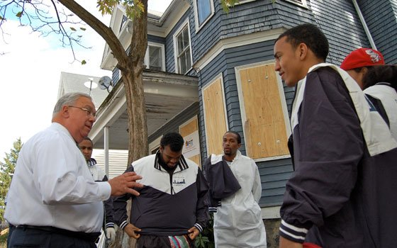 "Boston Mayor Thomas M. Menino talks with young men from the ""Mayor's Clean Team,"" hired to help maintain city-owned..."
