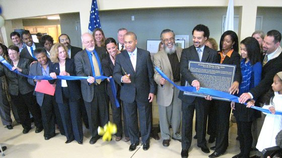 Gov. Deval Patrick cuts the ribbon at the grand opening celebration for the Thomas I. Atkins Apartments on...