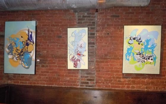 Abstract artwork by Elizabeth Kirby Sullivan hangs on the walls of Good Life.