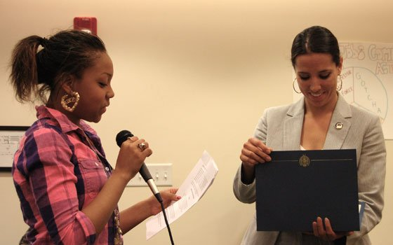Ashlee Smith of the Dorchester Bay Economic Development Corporation's Youth Force (left) presents an award to state Sen....