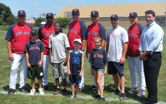 (Back row, from left): Boston Red Sox pitching coach John Farrell, third base coach DeMarlo Hale, batting coach...