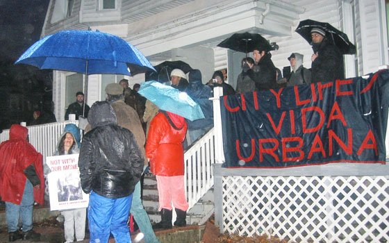 Protestors gathered in the rain outside a house on Bullard Street in Dorchester's Four Corners after a march around...