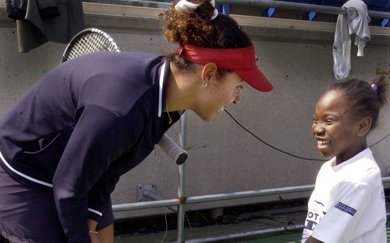 Professional tennis player Alexandra Stevenson (left) offers some career advice to Inasia Woods, a student at Barnard Elementary...
