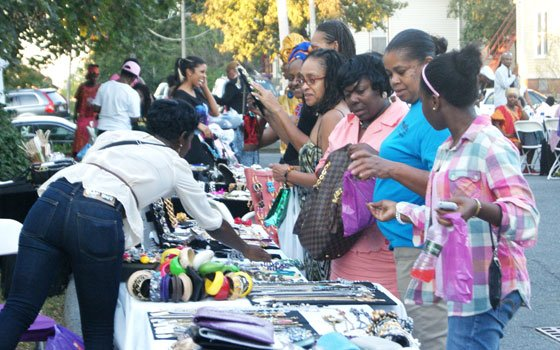 Attendees browse through the jewelry and accessories at the Cindy's Pieces booth at the Wrapping for a Cause...