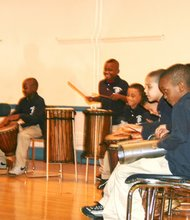 "Students from Higginson-Lewis School play the drums at the 100th Anniversary ""We Dare to Dream of Excellence"" party on Dec. 9."