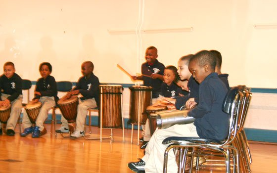 "Students from Higginson-Lewis School play the drums at the 100th Anniversary ""We Dare to Dream of Excellence"" party on..."