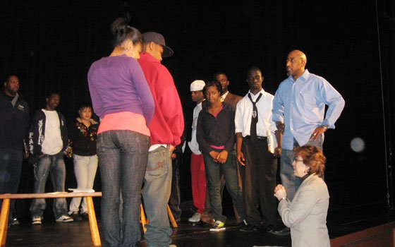 "Naheem Garcia (right) directs the students that make up the ensemble cast of ""Know the Law,"" a play that explores real issues facing teens today. The performance, part of a collaboration between the Huntington Theatre Company and Youth and Police in Partnership (YPP), aims to educate kids about the law by dramatizing a range of scenarios that they may one day encounter."