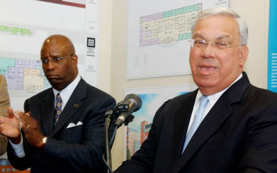 Urban League of Eastern Massachusetts President and CEO Darnell L. Williams (left) applauds as Mayor Thomas M. Menino...