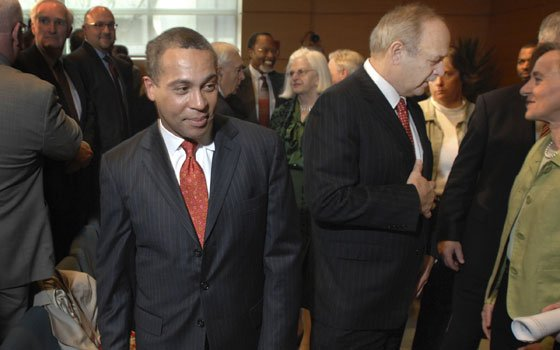 Gov. Deval Patrick passes then-House Speaker Salvatore F. DiMasi (second from right) as he leaves an auditorium after...
