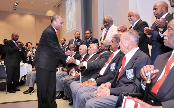 Gov. Deval Patrick greets members of the New England chapter of the Tuskegee Airmen at the Museum of African...