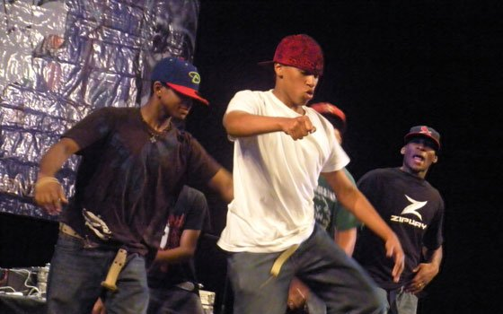 Paul Miranda (center), a founding member of the Royal Fam krumping crew, dances while surrounded by other members, Jordan Taylor (left) and Daniel Grant (right), at the 2009 Peace Boston Hip-Hop Festival.