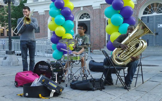 "Loubins Richard (r) plays the tuba with his trio ""Mobtet"" at Faneuil Hall. (Richard Feloni photo)..."