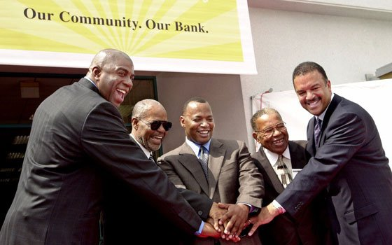 "Basketball great Earvin ""Magic"" Johnson, far left, and music industry executive Jheryl Busby, second from left, shareholders in..."