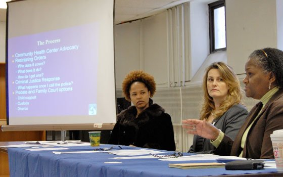 Evelyn Johnson (right), Boston Police Department victim advocate, explains the restraining order process at a domestic violence panel discussion...