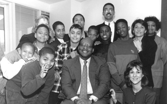 U.S. District Judge Reginald Lindsay (front, center) and a young Deval Patrick, then President Bill Clinton's nominee for the position of Assistant U.S. Attorney General for Civil Rights (back, center), pose with students and staff at the George A. Lewis Middle School in Roxbury, in this Banner file photo. Lindsay, the second black person to sit as a federal judge in Massachusetts, died March 12, 2009, after a series of illnesses. He was 63.