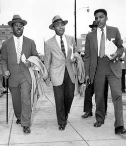 The Rev. Ralph Abernathy, left, Rev. Dr. Martin Luther King Jr., center, and Bayard Rustin, leaders in the racial bus boycott in Montgomery, Ala., leave the Montgomery County Courthouse on Feb. 24, 1956. The civil rights leaders were arraigned along with 87 other black activists. Thousands of supporters walked in protest against the mass indictments and arrests.