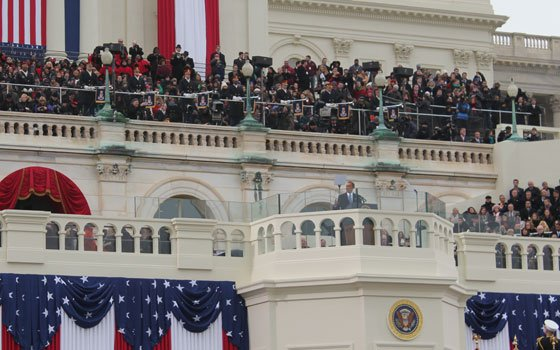 Obama's inaugural address before a crowd of 700,000 on Monday was lit by the torch...