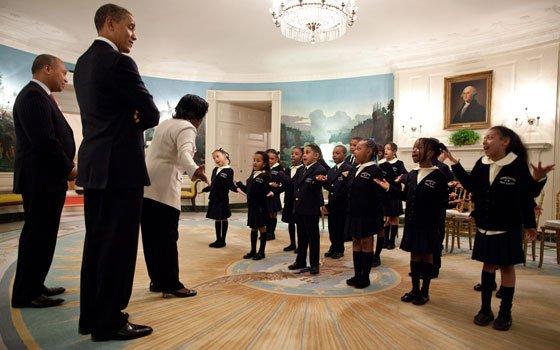 President Barack Obama and Massachusetts Governor Deval Patrick listen...
