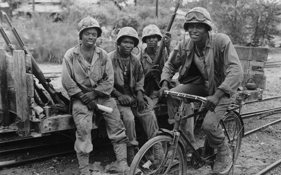 Four U.S. Marines are seen as they take a timeout from supplying ammunition to the frontlines during the...