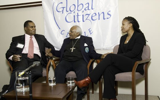 "Moderator Steven Curwood (left) joins panelists Archbishop Desmond Tutu (center) and environmental activist Majora Carter at the recent ""Green Justice: Caring for People and Planet Together"" forum, sponsored by the Global Citizens Circle and held at the South African consulate in New York City."